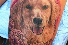 Dog flowers tattoo