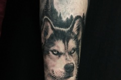 Dog moon tattoo